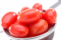 Tomates orgánicos de la uva roja Fotos de archivo