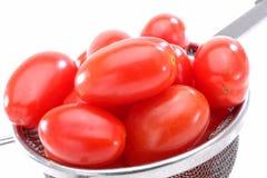 Tomates orgânicos da uva vermelha Fotos de Stock