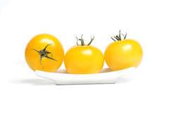 Tomates organiques jaunes Photo stock