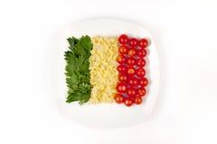 Tomates, pastas e hierba Imagen de archivo libre de regalías
