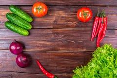 Tomates, pepinos, cebollas, verdes Imagen de archivo libre de regalías