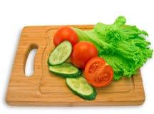 Tomates, pepinos e alface fotografia de stock