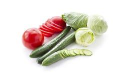 Tomates, pepinos y col. Fotos de archivo