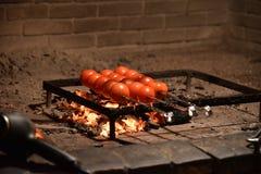 Tomates perforados con los pinchos en la participación Imagen de archivo libre de regalías