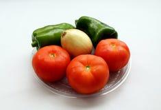 Tomates, pimientas y cebolla fotos de archivo