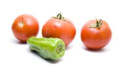 Tomates rojos con pimiento Imagen de archivo libre de regalías