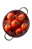 Tomates rojos en un colador Foto de archivo