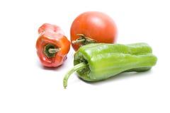 Tomates rojos frescos con el paprika Fotos de archivo