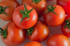 Tomates rojos grandes para el fondo Imagen de archivo libre de regalías
