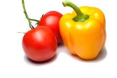 Tomates rouges et poivre jaune Photos stock