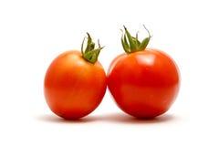 Tomates rouges sur le backgrou blanc Photographie stock libre de droits