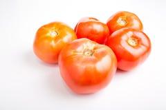 Tomates rouges sur le Tableau blanc Photographie stock libre de droits