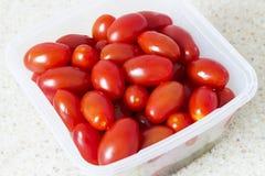 Tomates salgados vermelhos Imagens de Stock