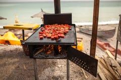 Tomates sur le gril Photographie stock