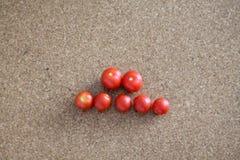 Tomates sur le tube de plancher Photographie stock