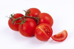 Tomates sur un fond blanc Photographie stock libre de droits