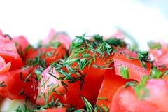 Tomates tajados para la ensalada Foto de archivo