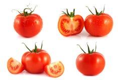 Tomates vermelhos ajustados isolados no fundo branco. Imagens de Stock