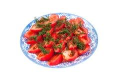 Tomates vermelhos em uma placa Imagem de Stock