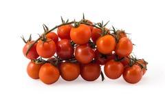 Tomates vermelhos frescos com refeição matinal verde no branco Imagem de Stock Royalty Free