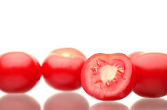 Tomates vermelhos frescos em um fundo branco Imagem de Stock Royalty Free