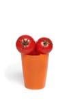 Tomates vermelhos no copo fotos de stock royalty free