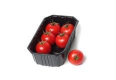 Tomates vermelhos no recipiente de alimento fotografia de stock