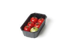 Tomates vermelhos no recipiente de alimento imagens de stock royalty free