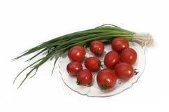 Tomates y cebolla verde Fotografía de archivo libre de regalías