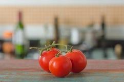 Tomates y cocina Imágenes de archivo libres de regalías