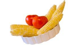 Tomates y espigas de trigo frescas Fotografía de archivo