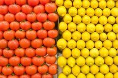 Tomates y limón empilados Imágenes de archivo libres de regalías