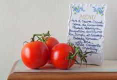 Tomates y menú frescos Imagen de archivo libre de regalías