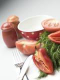 Tomates y paprika partidos en dos Imagen de archivo