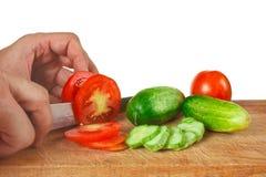 Tomates y pepinos de la tajada Fotos de archivo libres de regalías