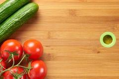 Tomates y pepinos frescos Fotografía de archivo libre de regalías