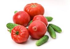 Tomates y pepinos rosados Imagenes de archivo