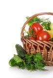 Tomates y pimienta en cesta foto de archivo libre de regalías