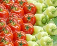 Tomates y pimientas Imágenes de archivo libres de regalías