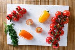 Tomates y pimientas Fotos de archivo