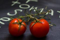 Tomates y romero de cereza fotos de archivo libres de regalías