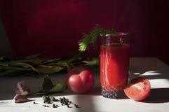 Tomatesaft in einem Glas Lizenzfreies Stockbild