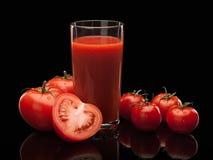 Tomatesap en tomaten Royalty-vrije Stock Fotografie