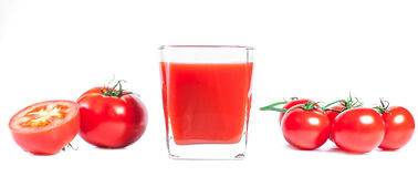 Tomatesap en Verse Tomaten Stock Afbeeldingen