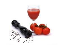 Tomatesap met peper   Stock Afbeelding