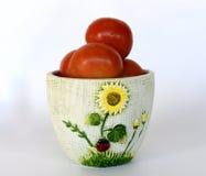 Tomatfrukt i en glass vas Fotografering för Bildbyråer
