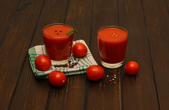 Tomatfruktsaft och kryddor Royaltyfria Bilder