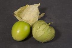 Tomatillos på en kritiserabakgrund Royaltyfri Fotografi