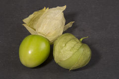 Tomatillos on a slate background. Tomatillos on a black slate background Royalty Free Stock Photography