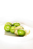 Tomatillos on white vertical Stock Image